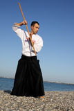Serious man exercising aikido Royalty Free Stock Photography