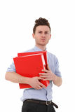 Serious man with folders Royalty Free Stock Photography