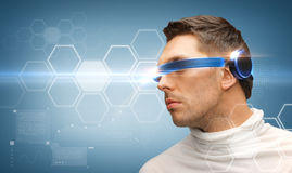 Serious man with futuristic glasses Royalty Free Stock Images