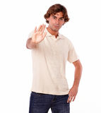 Serious man giving you high five with hand Stock Photo