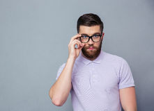 Serious man in glasses looking at camera Stock Photography