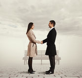 Serious man greeting the young woman Stock Images