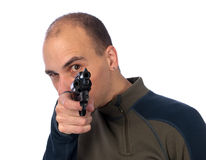 Serious man with a gun Stock Photography