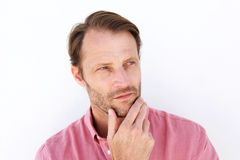 Serious man with hand to chin. Close up portrait of serious man with hand to chin Royalty Free Stock Photos
