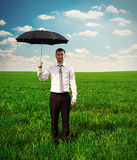 Serious man holding black umbrella Royalty Free Stock Photography