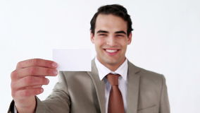 Serious man holding a business card stock footage