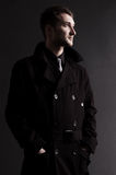 Serious Man In Black Cloak Royalty Free Stock Photography
