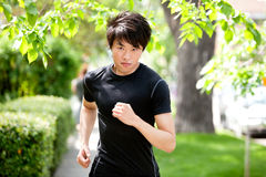 Serious man jogging Stock Photo