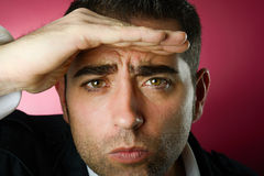Serious man looking at the background Royalty Free Stock Photography