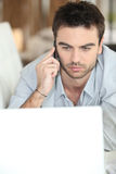 Serious man looking at laptop Royalty Free Stock Image