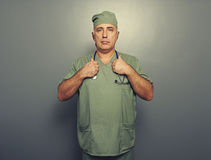 Serious man in medical uniform Stock Photos