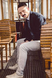 Serious man with a mustache in a suit with glasses posing and si Royalty Free Stock Photography