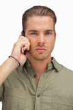 Serious man on the phone looking at camera Stock Image