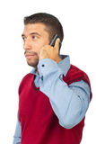 Serious man on phone mobile looking away Royalty Free Stock Photography