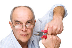 Serious man with pliers Stock Image