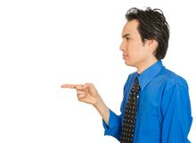 Serious man, pointing with index finger at someone Royalty Free Stock Image