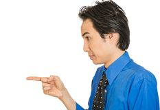 Serious man, pointing with index finger at someone Royalty Free Stock Photo