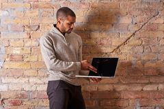 Serious man pointing to a laptop Stock Images