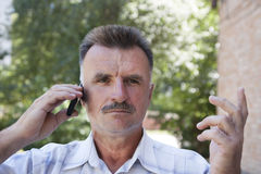 Serious man. Portrait a serious man with a mustache Royalty Free Stock Images