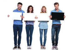 Serious man presening black card and friends white ones smiling Royalty Free Stock Photo