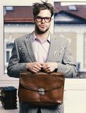 Serious man or professor with bristle in nerd glasses. Man with briefcase isolated on white background. Nerd wearing classic jacket. Education and work concept stock images
