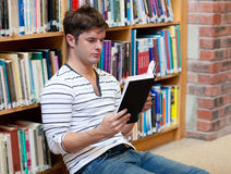 Serious man reading a book stock images