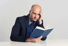 Serious man reading a book Stock Photo