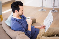 Serious man reading the news Royalty Free Stock Image