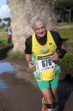 Serious man running Marathon of the Epiphany, Rome, Italy Stock Photo