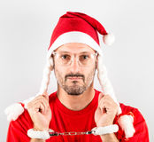 Serious man with Santa hat for Christmas Stock Photos