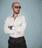 Serious man in shirt and sunglasses looking away Stock Images