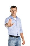 Serious man shows stop gesture Stock Photography