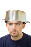 Serious man with stew pan on head Royalty Free Stock Photos