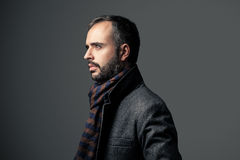 Serious man. Serious and stylish man in a grey background Stock Photo