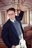 Serious man in suit with glasses posing and standing in an old t Stock Image