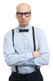 Serious man with suspenders and bow-tie Stock Photo