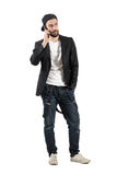 Serious man talking on the cellphone wearing hat backwards Stock Photos