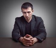 Serious man talks Stock Photos