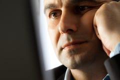 Serious man thinking Stock Photo