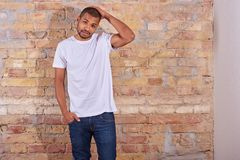 Serious man in a tshirt and jeans Stock Image