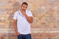 Serious man in a tshirt and jeans Royalty Free Stock Images