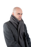 Serious man with tweed coat. Serious and angry bald man wearing  tweed coat and scarf. Looking at camera. Isolated Stock Image