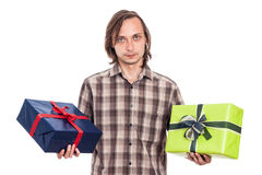 Serious man with two gifts Stock Images
