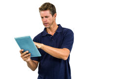 Serious man using digital tablet Royalty Free Stock Image