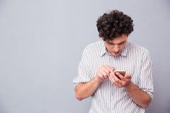 Serious man using smartphon Stock Photography