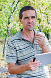 Serious man using a tablet Stock Photos