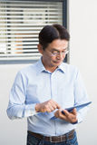 Serious man using tablet Stock Photography
