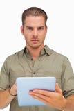 Serious man using tablet pc Royalty Free Stock Photos