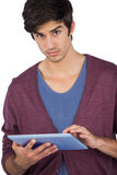 Serious man using tablet pc Stock Photos