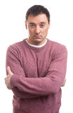 Serious man wearing sweater. Isolated on a white background Royalty Free Stock Photo